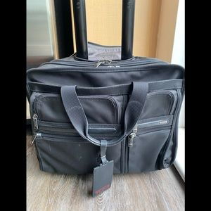 Tumi deluxe laptop brief travel bag with 4 wheels
